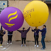 Meme Cronin (center) supervises the deflation of two Minnesota State University balloons at the end of Saturday's homecoming parade. Near the end of the deflation, Cronin and her friends breathed in some helium from the balloons to jokingly sing an MSU fight song in high pitches. Photo by Jackson Forderer