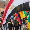 International students from Minnesota State University carry flags from their respective countries as the homecoming parade made its way along Front St. in downtown Mankato on Saturday. Photo by Jackson Forderer