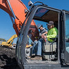 Riley Enter, 8, honks the horn on a backhoe being operated by Aaron Drummer at the Dig It! event held on Saturday. Children and adults were allowed to control certain parts of different construction equipment at the event. Photo by Jackson Forderer