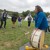 Londel Seaboy of the Sisseton-Wahpeton Tribe plays a drum while teaching sixth-grade students from Prairie Winds Middle School about Native music and dances on Friday at Land of Memories Park. Photo by Jackson Forderer