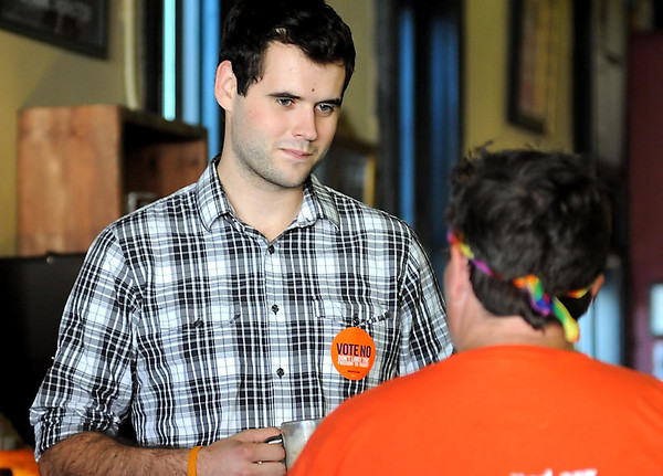 Zach Wahls, the son of lesbian parents who gave an impassioned speech Thursday at the Democratic National Convention, talks with people getting ready for Mankato's Pridefest parade Saturday at the Coffee Hag.