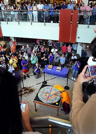 People gather in and above Minnesota State University's Hearth Lounge to watch a monk destroy a mandala sand painting during a ceremony Friday. The work, created over three days by monks from the Drepung Loseling Monastery, is destroyed at its conclusion to represent the impermance of all that exists.