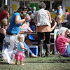 Lelia Leonhardt of St. Peter dances as her 13-month-old daughter Orla listens to the music during the Rock Bend Folk Festival Saturday.