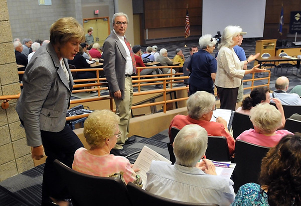 Pat Christman<br /> From left, Sen. Kathy Sheran, Rep. Clark Johnson and Rep. Kathy Brynaert collect questions from the audience prior to a forum on the overhaul of the nation's healthcare system Thursday at South Central College.