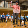 "Former U.S. Poet Laureate Juan Felipe Herrera holds up a ""book"" he said he recently wrote on a Starbucks napkin while reading some of his poems at the Performing Arts Center on the campus of Minnesota State on Wednesday. Herrera is the first Latino to hold the U.S. Poet Laureate position. Herrera, who will be performing at the Centennial Student Union at 7:30 p.m. today, said the book was unpublished. Photo by Jackson Forderer"