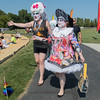 Anton Reichl (left) and Melissa Minehart wave at people gathering in Riverfront Park after the Pride Fest Parade on Saturday. The two said they belong to a charity organization called Sisters of Perpetual Indulgence and called themselves radical queer nuns. The international organization, of which Reichl and Minehart represent the Twin Cities chapter, helps out homeless LGBTQ youth and spreads joy. Photo by Jackson Forderer