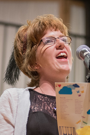 Melissa Steel reads a poem she wrote at the Performing Arts Center on the campus of Minnesota State on Wednesday. Steel and others in the Aktion Club Theater Poets group shared the stage with former U.S. Poet Laureate Juan Felipe Herrera. Photo by Jackson Forderer