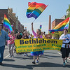 Maria Larson (center) leads members of Bethlehem Lutheran Church down Riverfront Drive during the Pride Fest Parade held on Saturday. Various groups came out to show their support for the LGBTQ community. Photo by Jackson Forderer