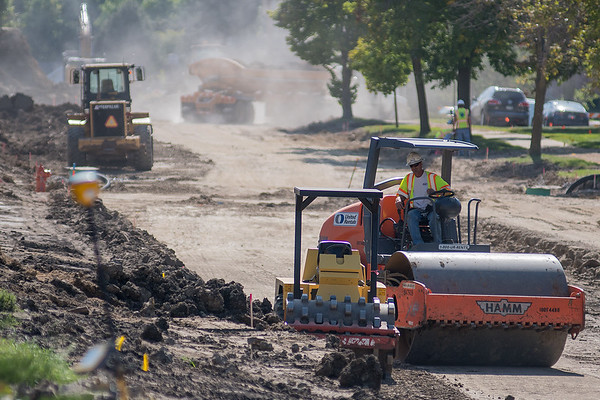 Construction workers work along 5th St. in Mankato on Friday afternoon. Photo by Jackson Forderer