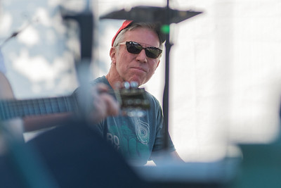 Ron Arsenault, who organized and emceed a question and answer session with local musicians, watch them play at the Rock Bend music festival. Photo by Jackson Forderer