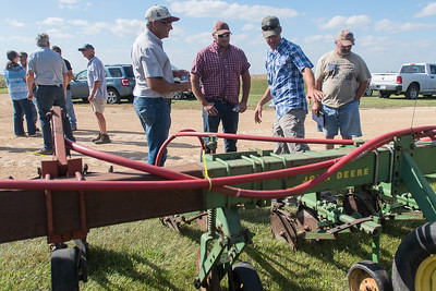 Dan Coffman (second from right) talks with other farmers about cover crops at the Oshawa Township Hall on Thursday. Photo by Jackson Forderer