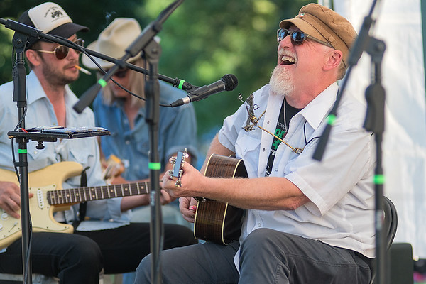 Charlie Roth leans back and laughs during one of his songs at the Rock Bend Music Festival. Photo by Jackson Forderer