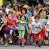 """Daley Preston, No. 231, left, Ashley Harvey, No. 411, Sydney Curran, No. 338, Gordy Nilsen, No. 426 and Jack Leoni, No. 250, sprint out of the start gate while racing in the kids division during the West End 3K on Thursday, July 19, on Pearl Street in Boulder. For more photos and video of the race go to  <a href=""""http://www.dailycamera.com"""">http://www.dailycamera.com</a><br /> Jeremy Papasso/ Camera"""