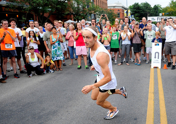"""Kenyon Neuman, of Boulder, rounds the corner for his second lap during the competitive men's race during the West End 3K on Thursday, July 19, on Pearl Street in Boulder. Neuman won the race. For more photos and video of the race go to  <a href=""""http://www.dailycamera.com"""">http://www.dailycamera.com</a><br /> Jeremy Papasso/ Camera"""