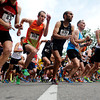 """Ofer Barniv, No. 83, left, Greg Reindl, No. 108, and Pat Hunt, No. 430, sprint out of the start gate in the competitive men's race during the West End 3K on Thursday, July 19, on Pearl Street in Boulder. For more photos and video of the race go to  <a href=""""http://www.dailycamera.com"""">http://www.dailycamera.com</a><br /> Jeremy Papasso/ Camera"""