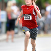 """Leon Engle, 9, digs deep while sprinting to the finish line while competing in the kids race during the West End 3K on Thursday, July 19, on Pearl Street in Boulder. Engle won the race. For more photos and video of the race go to  <a href=""""http://www.dailycamera.com"""">http://www.dailycamera.com</a><br /> Jeremy Papasso/ Camera"""