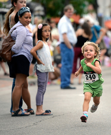 "Tallulah Graham, 3, of Boulder, sprints towards the finish line while racing in the kids race during the West End 3K on Thursday, July 19, on Pearl Street in Boulder. For more photos and video of the race go to  <a href=""http://www.dailycamera.com"">http://www.dailycamera.com</a><br /> Jeremy Papasso/ Camera"