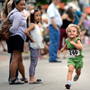 """Tallulah Graham, 3, of Boulder, sprints towards the finish line while racing in the kids race during the West End 3K on Thursday, July 19, on Pearl Street in Boulder. For more photos and video of the race go to  <a href=""""http://www.dailycamera.com"""">http://www.dailycamera.com</a><br /> Jeremy Papasso/ Camera"""