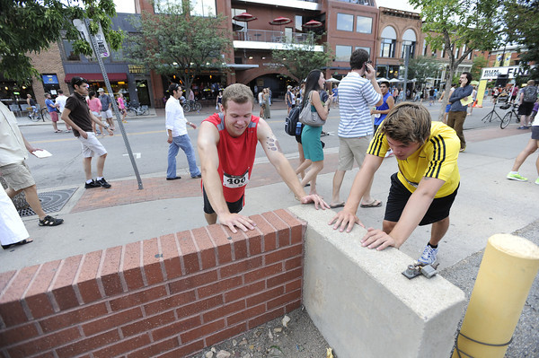 "Greg Schoeninger, left, and Lars Kossmann stretch after competing during the West End 3K on Thursday, July 19, on Pearl Street in Boulder. For more photos and video of the race go to  <a href=""http://www.dailycamera.com"">http://www.dailycamera.com</a><br /> Jeremy Papasso/ Camera"