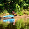 KRISTOPHER RADDER — BRATTLEBORO REFORMER<br /> Sarah Gonzales relaxes with her journal after kayaking for a bit on the West River on Friday, July 26, 2019.