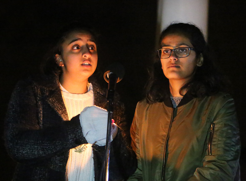 Westford Academy seniors Medha Palmati, left, and Prachi Jhawar speak about the Second Amendment and guns as First Parish Church United of Westford holds a candlelight vigil for victims of gun violence on the fifth anniversary of the Sandy Hook Elementary School shooting.  (SUN/Julia Malakie)