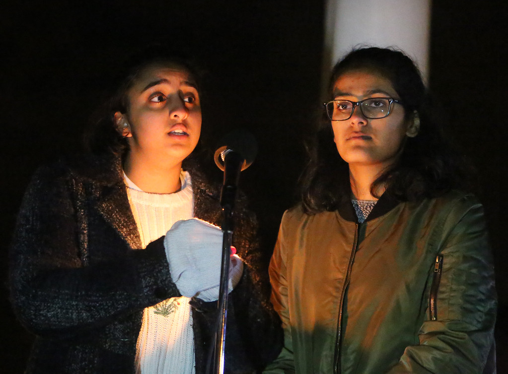 . Westford Academy seniors Medha Palmati, left, and Prachi Jhawar speak about the Second Amendment and guns as First Parish Church United of Westford holds a candlelight vigil for victims of gun violence on the fifth anniversary of the Sandy Hook Elementary School shooting.  (SUN/Julia Malakie)
