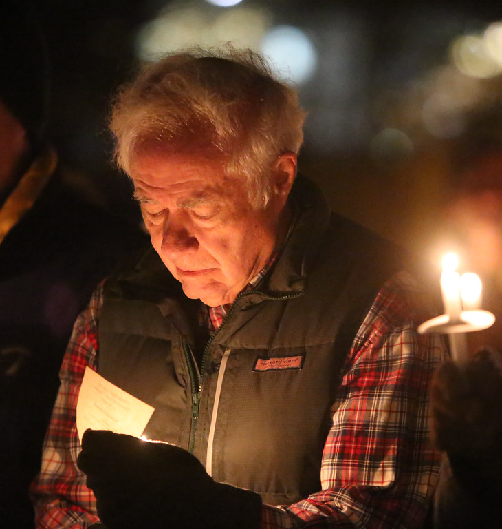 . Robert Shaw of Groton, a member of First Parish Church United of Westford, as the church holds a candlelight vigil for victims of gun violence on the fifth anniversary of the Sandy Hook Elementary School shooting.  (SUN/Julia Malakie)
