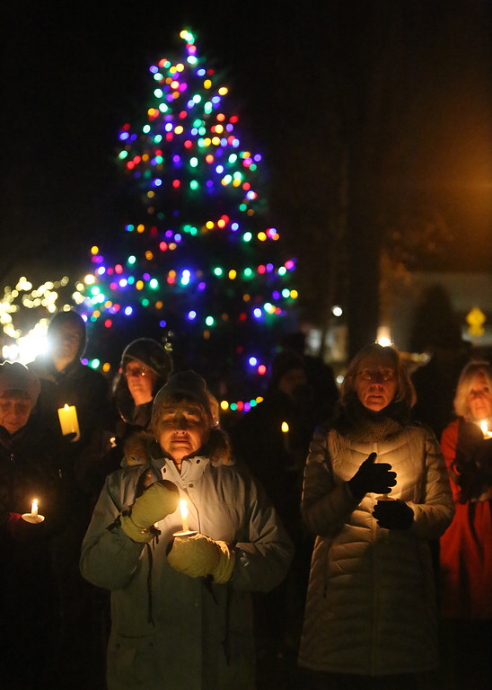. First Parish Church United of Westford holds a candlelight vigil for victims of gun violence on the fifth anniversary of the Sandy Hook Elementary School shooting.  (SUN/Julia Malakie)