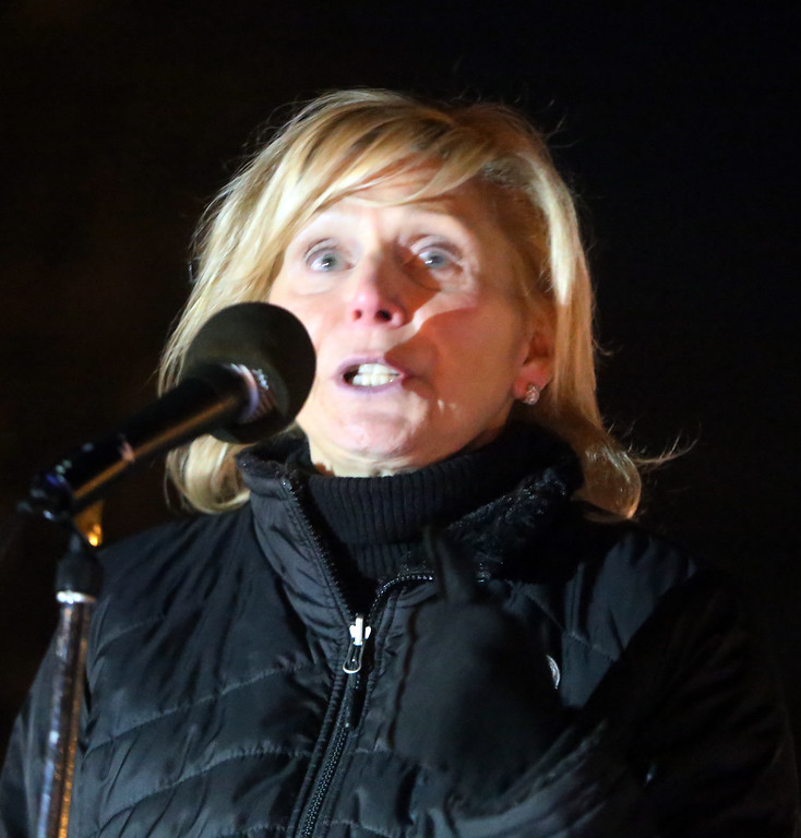 . Jody Marchand of Westford and Live for Liv, tells how her husband fatally shot their daughter before killing himself, as the First Parish Church United of Westford holds a candlelight vigil for victims of gun violence on the fifth anniversary of the Sandy Hook Elementary School shooting.  (SUN/Julia Malakie)