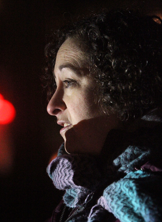 . Gail Johnson, public health nurse and member of Westford Coalition for Non-Violence, speaks as First Parish Church United of Westford holds a candlelight vigil for victims of gun violence on the fifth anniversary of the Sandy Hook Elementary School shooting.  (SUN/Julia Malakie)