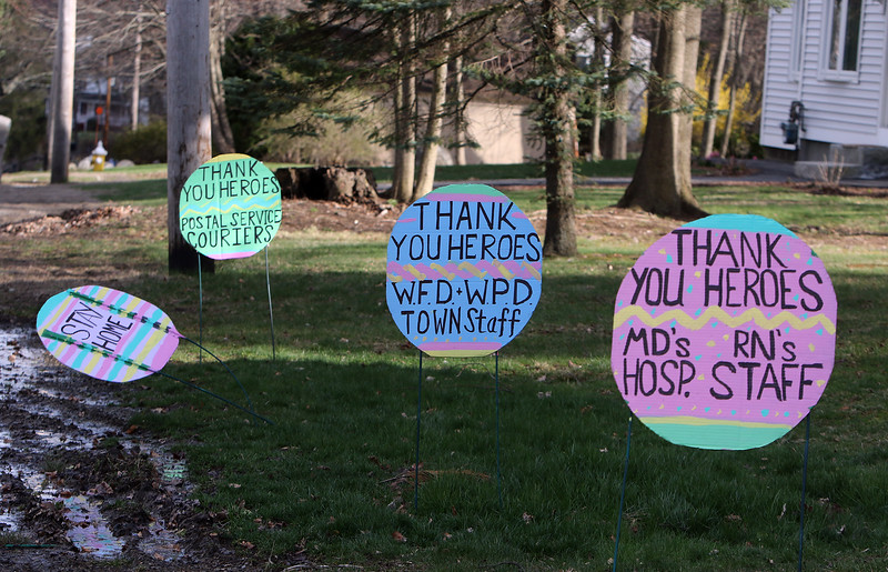Thank you signs, resembling Easter eggs, to workers at risk during COVID-19 pandemic emergency, at 25 Boston Road in Westford. (SUN/Julia Malakie)