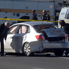 Criminalists look at the suspect's vehicle at the scene of a shoot out with Westminster Police at eastbound 120th Ave. and Federal Blvd. on Thursday.<br /> Two Westminster officers were shot in the gun battle. <br /> November 19, 2009<br /> Staff photo/David R. Jennings
