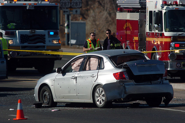 The suspect's car at the scene of a Westminster Police shoot out at eastbound 120th Ave. and Federal Blvd. on Thursday.<br /> Two Westminster officers were shot in the gun battle. Federal is closed both directions from Federal Blvd. to Pecos St.<br /> November 19, 2009<br /> Staff photo/David R. Jennings