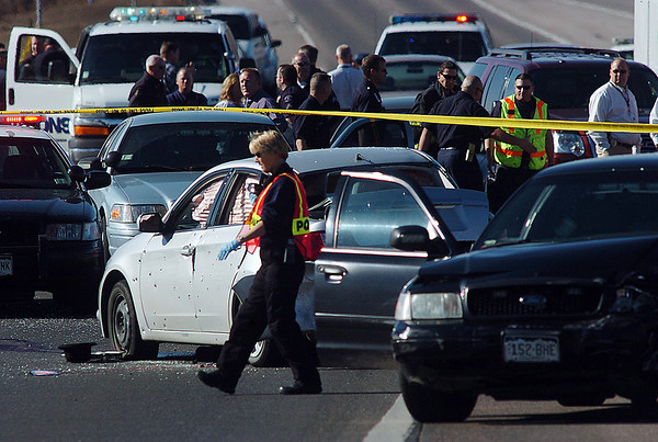 A Westminster criminalist at the scene of a Westminster Police shootout at eastbound 120th Ave. and Federal Blvd. on Thursday.<br /> Two Westminster officers were shot in the gun battle. Federal is closed both directions from Federal Blvd. to Pecos St.<br /> November 19, 2009<br /> Staff photo/David R. Jennings