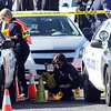 BE1122SHOO<br /> Broomfield Police criminalist Brenda Harris marks rounds at the scene of a Westminster Police shoot out at eastbound 120th Ave. and Federal Blvd. on Thursday.<br /> Two Westminster officers were shot in the gun battle. Federal is closed both directions from Federal Blvd. to Pecos St.<br /> November 19, 2009<br /> Staff photo/David R. Jennings