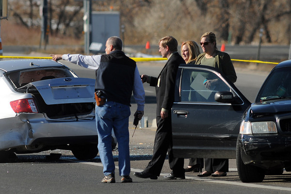 Investigators at the scene of a shoot out with Westminster Police at eastbound 120th Ave. and Federal Blvd. on Thursday.<br /> Two Westminster officers were shot in the gun battle. Federal is closed both directions from Federal Blvd. to Pecos St.<br /> November 19, 2009<br /> Staff photo/David R. Jennings
