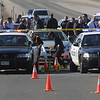 Broomfield and Westminster Police criminalists mark rounds at the scene of a Westminster Police shoot out at eastbound 120th Ave. and Federal Blvd. on Thursday.<br /> Two Westminster officers were shot in the gun battle. Federal is closed both directions from Federal Blvd. to Pecos St.<br /> November 19, 2009<br /> Staff photo/David R. Jennings