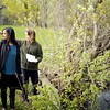 BEN GARVER — THE BERKSHIRE EAGLE<br /> Architect Tessa Kelly (right) and planner Tanu Kumar examine the Westside Riverway Park along the housatonic River in Pittsfield on Dewey Street. The park will be a centerpiece of a walking route along the river.