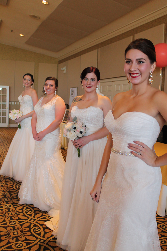 LAWRENCE PANTAGES / GAZETTE The Dress Bridal Boutique of Medina supplied samples of wedding dresses that models displayed during the first Bridal Expo event held at Weymouth Country Club in Medina Township on Sunday. Organizers said about 175 people and 34 vendors participated in the event displaying wedding services.