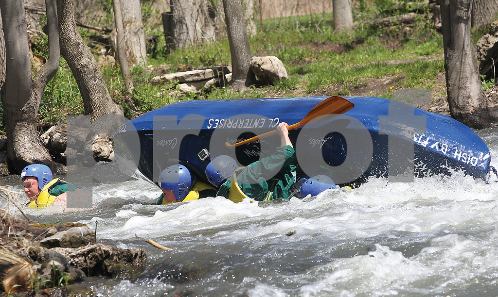 Spencer Tulis / Finger Lakes Times<br /> There were thrills and spills at the annual Wild Water Derby in Shortsville Saturday. Kayakers, canoes and homemade rafts made their way on the Canandaigua Outlet starting from Littleville to Shortsville.