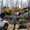 Photo by Eveleigh Stewart<br /> On January 14th, 2009, a tree falls ontop of a trackhoe and nearby powerlines, pinning a man inside on Willow Springs Road. No injuries were reported.