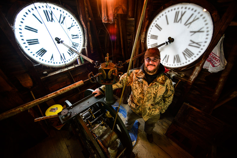 KRISTOPHER RADDER - BRATTLEBORO REFORMER<br /> Robert Leustek, of Winchester, N.H., pictured on March 6, 2017, has been working on restoring the Center Church clock and bell since October 2016 . Leustek hopes to have the project completed by March of 2018.
