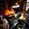 KRISTOPHER RADDER - BRATTLEBORO REFORMER<br /> Robert Leustek, of Winchester, N.H., works at home on cleaning the gears of the Center Church bell system n March 6, 2017. Leustek has been working on restoring the clock and bell since October 2016. He hopes to have the project completed by March of 2018.