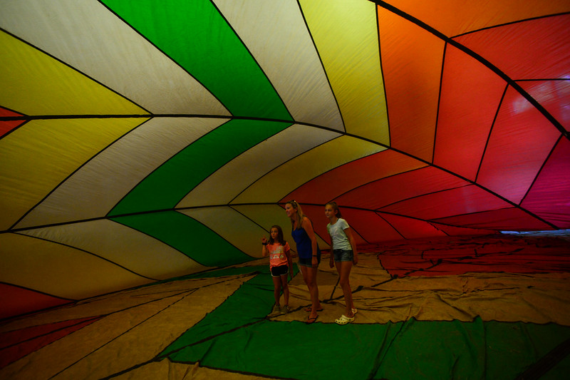 KRISTOPHER RADDER — BRATTLEBORO REFORMER<br /> Kathy Hallock, of Westminster, and her two daughters, Olivia, 11, and Addison, 8, tour the inside of a hot air balloon during the Winston Prouty Center for Child and Family Development's 50th anniversary party on Saturday, Aug. 3, 2019.