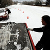 James Barr, 27, of Lafayette, works to tow his wife Ashley, 27, at left,  out of a ditch on South Boulder Road in Louisville during a snowstorm on Thursday, Dec. 30.<br /> Jeremy Papasso/Camera