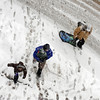 """Pedestrians cross 14th Street along Walnut in Boulder through the Thursday snow.<br /> For more photos and a video of the storm, go to  <a href=""""http://www.dailycamera.com"""">http://www.dailycamera.com</a>.<br /> Cliff Grassmick / December 30, 2010"""
