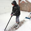 Haley Djay, 11, and sister Vienna, 10 help out by shoveling their neighbors walkways on a snowy morning in Lafayette. Photo by Paul Aiken <br /> December 30 2010
