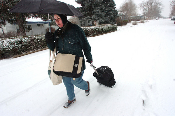 Mara Dante walk home from shopping on a deserted road on a snowy morning in Lafayette. Photo by Paul Aiken <br /> December 30 2010
