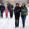 "Gertrude O'Malley, left, and Dylan Beales, try to keep each other warm as they walk along Pearl Street.<br /> For more photos and a video of the storm, go to  <a href=""http://www.dailycamera.com"">http://www.dailycamera.com</a>.<br /> Cliff Grassmick / December 30, 2010"
