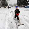 SNOW<br /> Grant Sims, 3, helps to shovel sidewalks in his neighborhood in Boulder.<br /> Photo by Marty Caivano/Dec. 30, 2010
